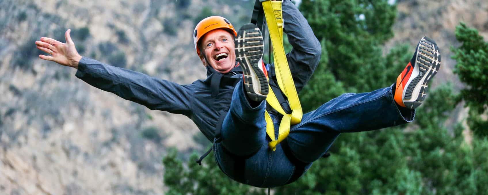 man-ziplining-laughing