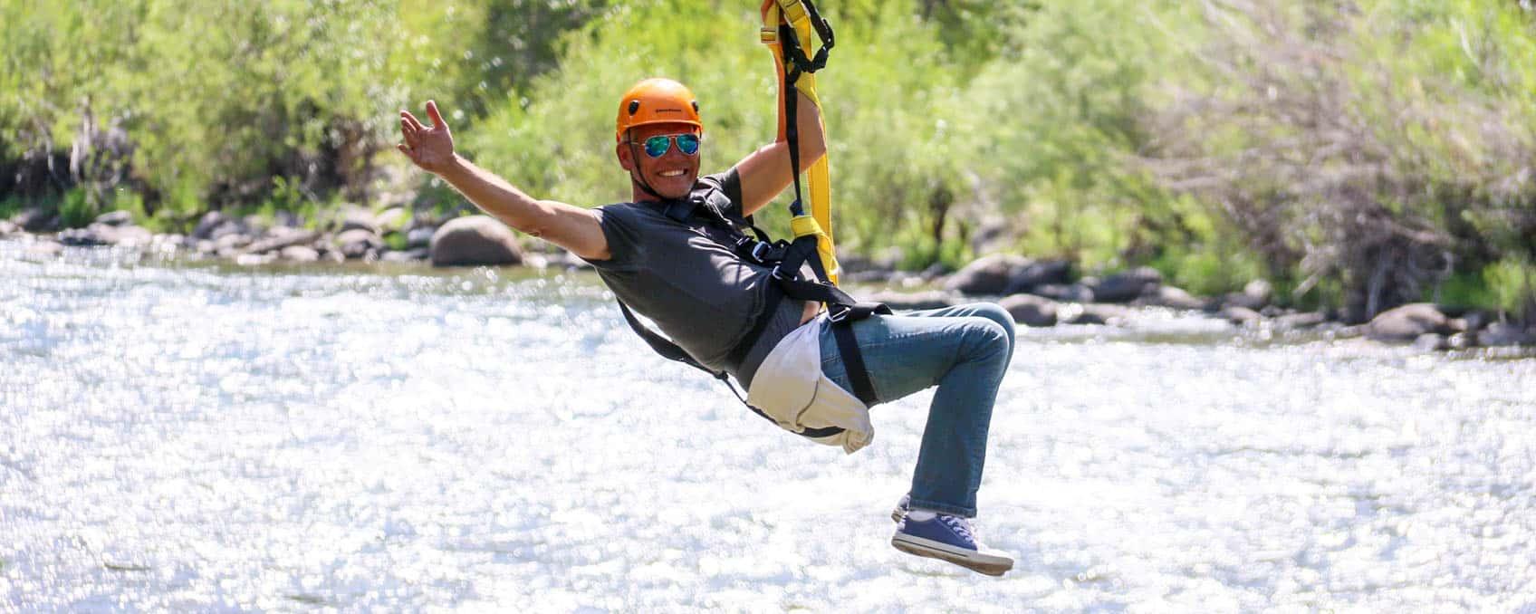 man-ziplining-waving