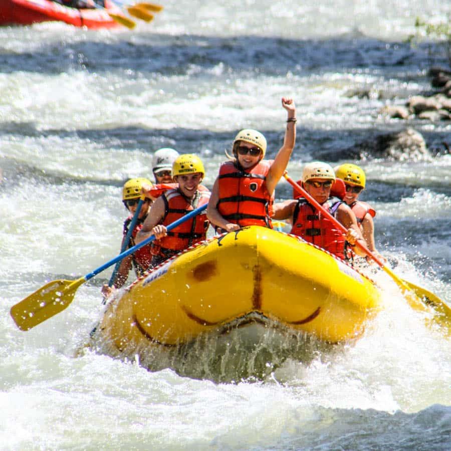 yellow-raft-girl-waving